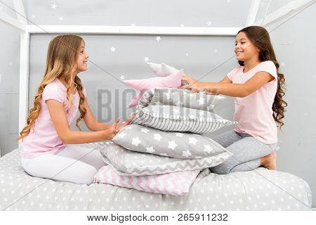 Girls Happy Best Friends In Pajamas With Pillows Sleepover Party. Soulmates Girls Having Fun Sleepov