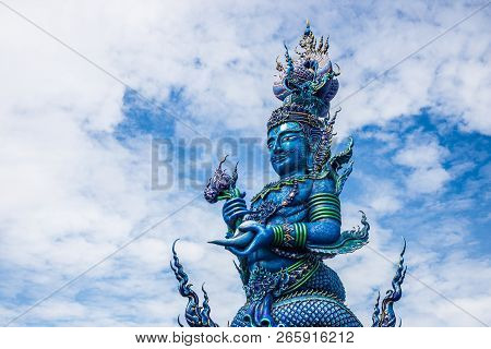 Pole Carve Of Art Fairy Tale At Wat Rong Sua Ten Temple With Blue Sky Background, Chiang Rai Provinc