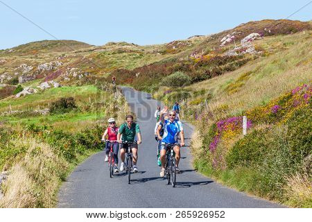 Clifden, Ireland - August 17, 2012: Unidentified Cyclists Riding Along The Sky Road, Near Clifden In