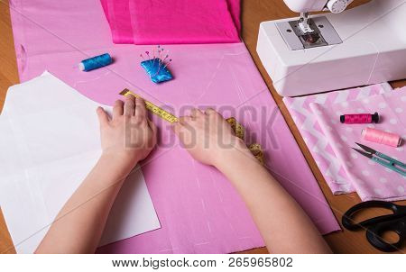 Female Hands Of A Seamstress Making A Pattern In The Workplace Of A Seamstress