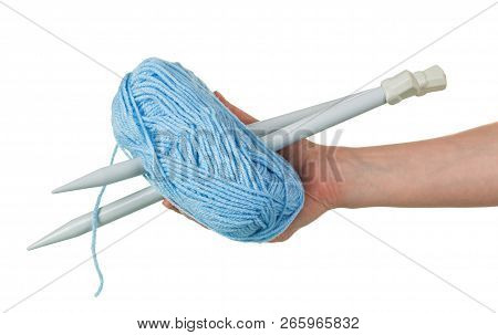 Blue Skein Of Wool And Knitting Needles In Female Hands Isolated On White Background