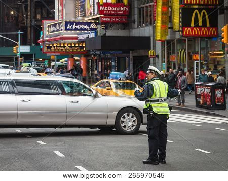 New York, Usa - May 03, 2016: Police Officer Performing His Duties On The Streets Of Manhattan. New