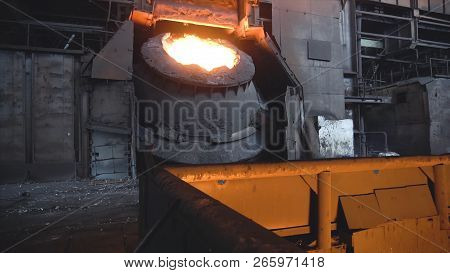 Metal Smelting In Steel Mill Furnace. Footage. Top View On Pot Of Solidified Metal Next To Sprinkles