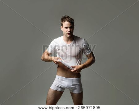 Strong Athletic Man In Underwear. Sexy Erotic Handsome Man In Wet T-shirt. Sensual Man In Underwear.