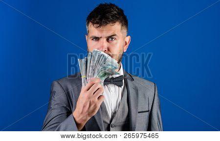 Easy Cash Loans. Man Formal Suit Hold Pile Of Dollar Banknotes Blue Background. Businessman Got Cash