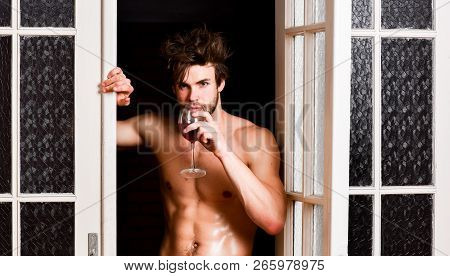 Guy Smooth Skin Posing Seductive. Beginning Great Evening. Man With Sexy Torso Drink Wine. Bachelor