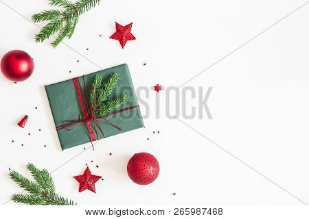 Christmas Composition. Gift, Fir Tree Branches, Red Decorations On White Background. Christmas, Wint