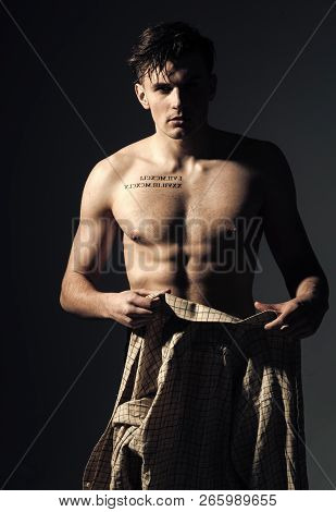 Man With Torso, Muscular Macho With Six Packs, Dressing Shirt, Dark Background. Macho On Pensive Fac