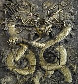 stucco golden dragon on the temple wall Thailand poster