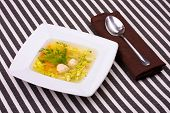 vegetable soup in white bowl with a spoon poster