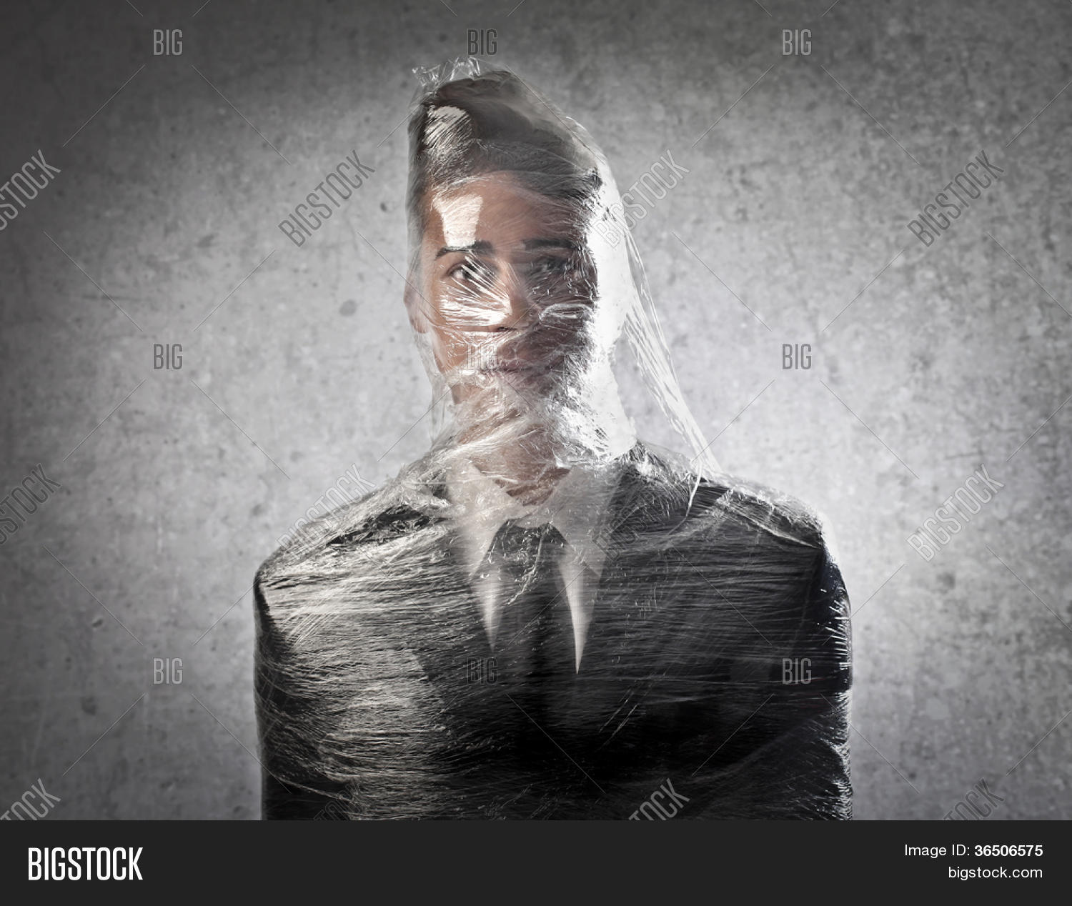 Dummy dressed as a businessman packed in plastic wrap