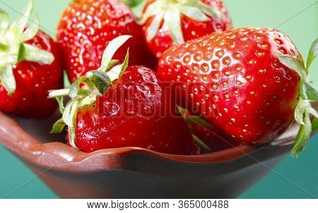 Fruit Background. Close-up Red Strawberry In A Brown Plate. Strawberry Berries Texture. Beautiful Cl