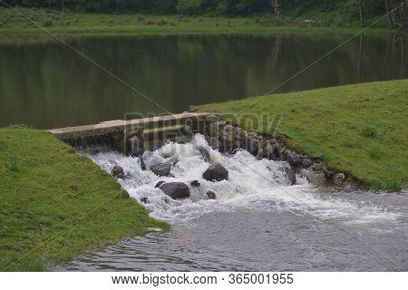 Stone Bridge Over Ponds And Streams In La Pudacuo National Park, Shangri-la, Yunnan