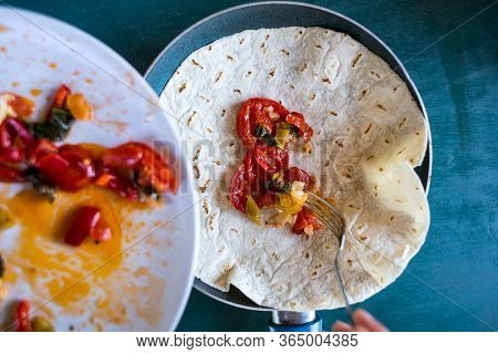 Cooking Pita Rolls Stuffed With Vegetables. Stuffing For Tacos. Eastern Cuisine. Pita Bread In A Pan