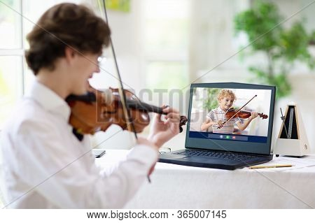Violin Lesson Online. Teacher And Child Play Violin Via Computer. Remote Learning From Home