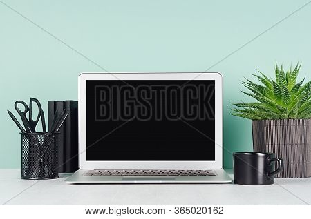Spring Workplace With Blank Notebook Screen, Black Stationery, Books, Aloe Plant In Ribbed Pot, Coff