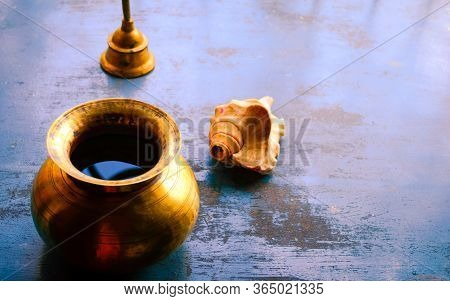 Close Up Still Life Of Antique Holi Water Pot And Bell And Conch Shell On Rustic Floor. Faith, Tradi