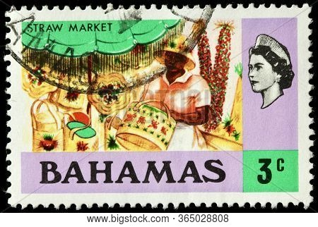 Luga, Russia - October 5, 2019: A Stamp Printed By Bahamas Shows View Of The Nassau Straw Market Loc