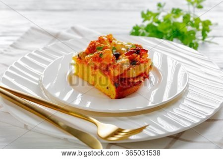 Restaurant Serving Of Chicken Tamale Pie With A Cornmeal Mix Crust, Cheddar Cheese, Black Beans Serv