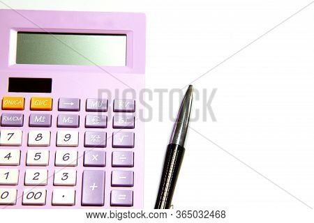 Purple Calculator And Pen On A White Background