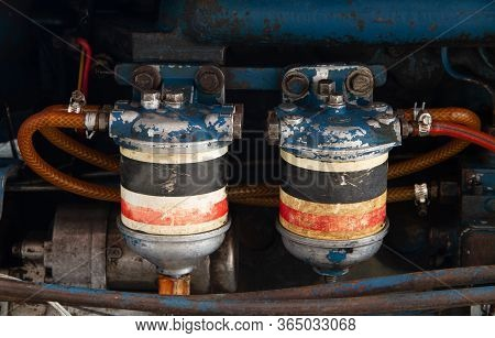 Fuel  Oli And Hydraulic Fluid Filters On Modern Tractor Engine, Farming Machinery Maintenance Servic