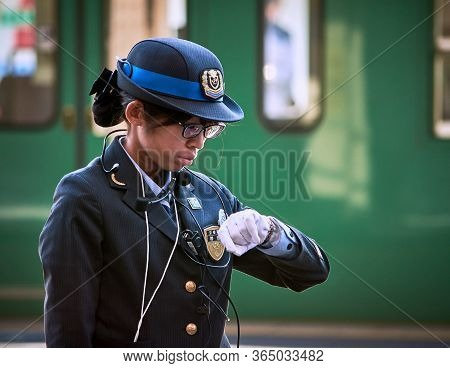 Kyoto / Japan - November 3, 2017: Female Train Station Officer Checking The Time In Kyoto Station, K
