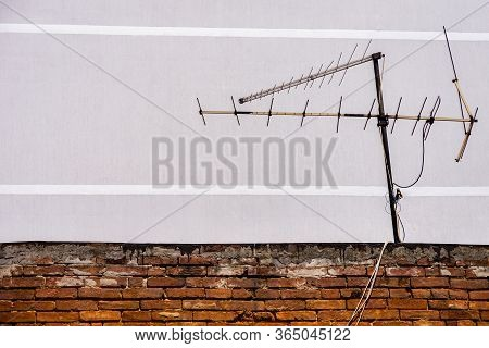 Analogue Television Antenna On The Vintage Roof Tiles