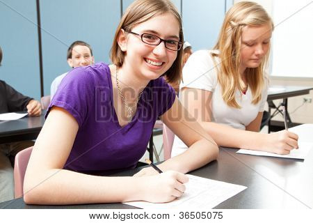Teenage girls in high school class.  Real people.