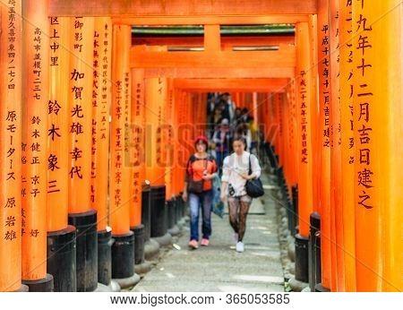 Kyoto / Japan - November 3, 2017: Famous Fushimi Inari Shinto Shrine With Its Red Torii Gates In Kyo
