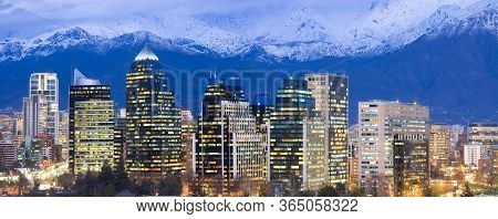 Skyline Of Modern Office Buildings At Las Condes And Providencia Districts With Snowed Andes Mountai
