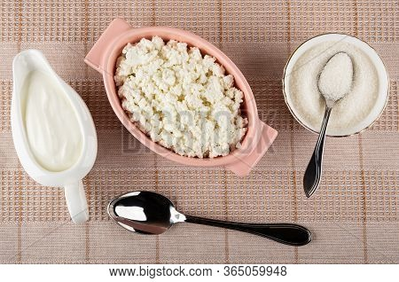 White Sauceboat With Sour Cream, Pink Glass Bowl With Defatted Grained Cottage Cheese, Teaspoon In B