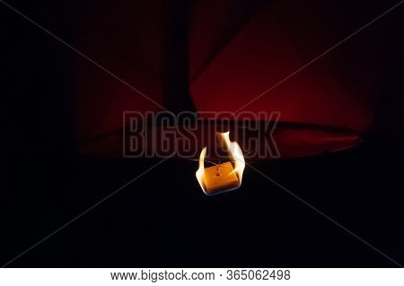 Detail Of Launching Sky Lantern. Close Up Ignite Flying Lantern, Floating Lantern. Fire And Hot-air