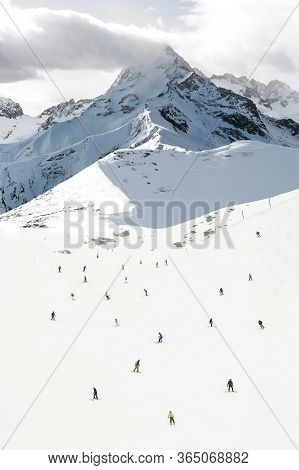 Lots Of Skiers And Snowboarders, Large Group. Top Perspective View