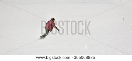 Speed Feeling. Fast Motion Effect. Freeride Snowboarder Rides His Board On The Mountain. Winter Seas
