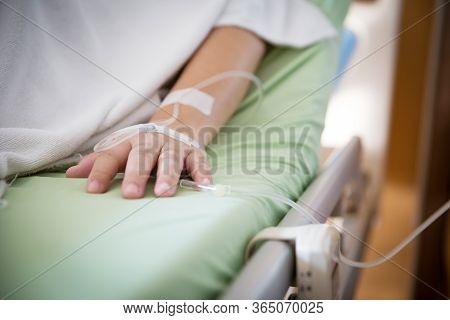 Focus Patient\'s Hand Has Get The Saline Solution Syringe On It. Illness And Treatment. Health Insur