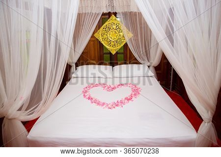 Bed room in luxury honeymoon sweet suits. Honey moon bed.Honeymoon, Wedding bed topped with rose and