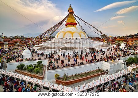Kathmandu, Nepal - June 30 2019: Crowd Of Buddhist Devotees Circulating The Holy Boudhanath Stupa On