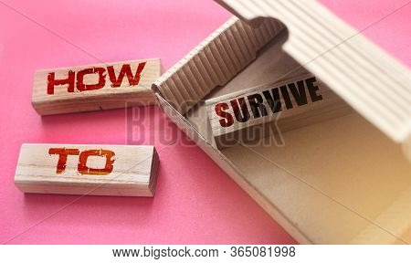 How To Survive Wooden Blocks In Box And Outside. Survival Concept. Risky Business Startup Concept