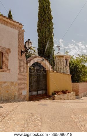 Nice Entrance To A Centennial House With A Battlement To One Side In Hita. July 23, 2019. Hita Guada