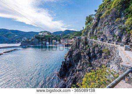 MONTEROSSO ITALY, MAY 19, 2018: TOURISTS ON THE TRAIL AT THE COASTLINE OF MEDITERRANEAN SEA NEAR MONTEROSSO.
