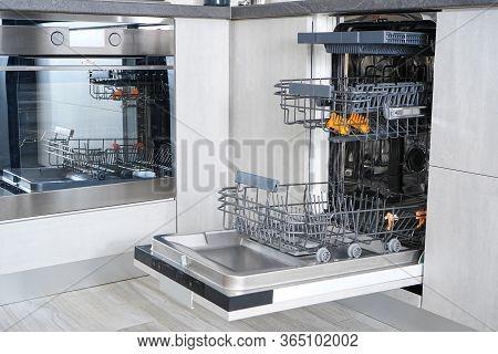 Washing Dishes In The Dishwasher. Open, Empty Dishwasher.