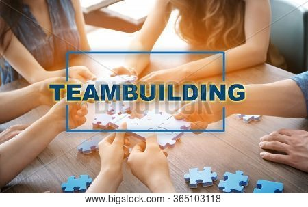 People With Puzzle, Closeup Of Hands. Teambuilding Concept