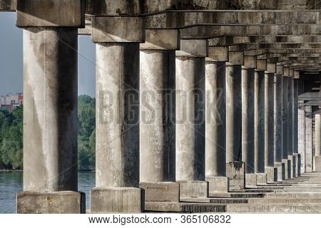 Old Stone Columns. Ancient Colonnade. Corridor With Columns.