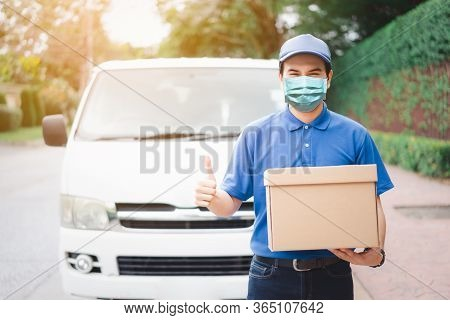 Postal Delivery Courier Man Thumbs Up Wearing Protective Face Mask In Front Of Cargo Van Delivering