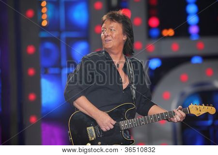 MOSCOW - DEC 17: Chris Norman playing guitar during concert of Legend RetroFM in Sports complex Olimpiyskiy, Dec 17 2011, Moscow, Russia. C.Norman wanted to link their lives with music since childhood