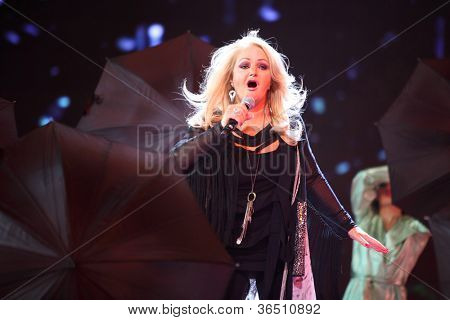 MOSCOW - DEC 17: Bonnie Tyler sing during concert of Legend RetroFM in Sports complex Olimpiyskiy, Dec 17, 2011 in Moscow, Russia. In 1975 B.Tyler released first solo single performer My My Honeycomb.