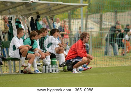 KAPOSVAR, HUNGARY - SEPTEMBER 1: Sandor Richter Kaposvar trainer (R) in action at the Hungarian Championship u16 game Kaposvar  (green) vs Videoton (blue) September 1, 2012 in Kaposvar, Hungary.