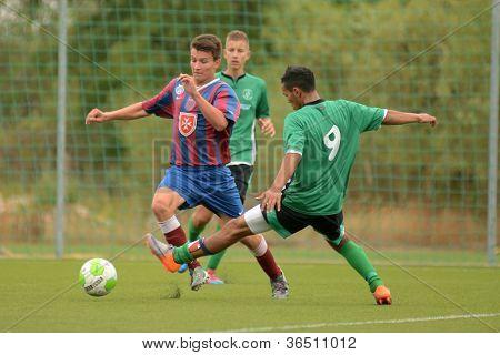 KAPOSVAR, HUNGARY - SEPTEMBER 1: Viktor Somogyi (9) in action at the Hungarian National Championship under 18 game between Kaposvar (green) and Videoton (blue) September 1, 2012 in Kaposvar, Hungary.