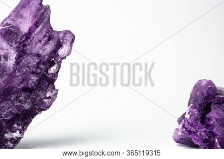 Two Pieces Of Purple Natural Gem On Light Backdrop. Template Or Mockup For Banners, Goods, Natural C