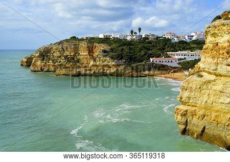 Benagil, Algarve, Portugal - October 27, 2015 : Tourists On Benagil Beach On The Algarve Coast In Po